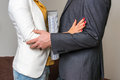Man touching woman`s elbow - sexual harassment in office Royalty Free Stock Photo