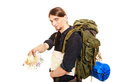 Man tourist backpacker paying euro money travel with holding map young guy hiker backpacking summer vacation isolated on white Royalty Free Stock Photography