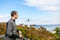 Man tourist looking away. At the background the Portland Headlight Lighthouse Royalty Free Stock Photo