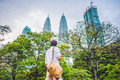 Man tourist in Malaysia looks at the Petronas Twin Towers Royalty Free Stock Photo