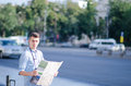 Man with a tourist map young orients himself in the city using paper Stock Photos