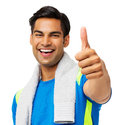 Man with towel around neck gesturing thumbs up portrait of confident fit over white background horizontal shot Stock Image