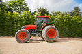 Man with tractor in a garden blurred motion the Stock Photo