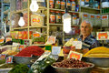 Man trades traditional iranian food and spices Royalty Free Stock Photo