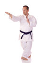Man traditional clothing doing karate Royalty Free Stock Photo