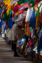 Man in traditional dress stands between prayer flags on bridge i thimphu bhutan september september thimphu bhutan nearly all Royalty Free Stock Photography