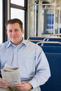 Man on train with newspaper Stock Photos