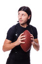 Man training with american football on white Stock Images