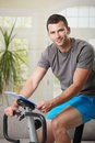 Man training on exercise bike Royalty Free Stock Images