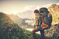 Man traveler with big backpack mountaineering travel lifestyle concept lake and mountains on background summer adventure vacations Royalty Free Stock Image