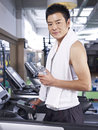 Man on treadmill taking a break while exercising Royalty Free Stock Image