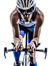 Man triathlon iron man athlete cyclist bicycling biker biking in silhouette on white background Stock Photography