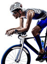 Man triathlon iron man athlete cyclist bicycling biker biking in silhouette on white background Stock Photo