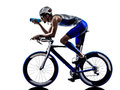 Man triathlon iron man athlete cyclist bicycling drinking biker biking in silhouette on white background Royalty Free Stock Photo