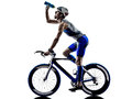 Man triathlon iron man athlete cyclists bicycling drinking bikers biking in silhouettes on white background Royalty Free Stock Images