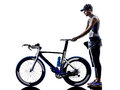Man triathlon iron man athlete equipment standing with all his in silhouette on white background Royalty Free Stock Photos