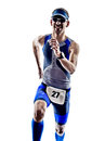 Man triathlon iron man athlete runners running in silhouettes on white background Stock Images