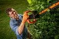 Man trimming bushes Royalty Free Stock Photo