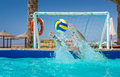 Man trying to catch the ball in pool playing water polo Royalty Free Stock Photo