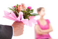 Man trying to offer an apology to his wife with flowers Stock Photography