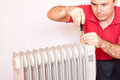 Man trying to repair a radiator studio shot isolated Royalty Free Stock Photography