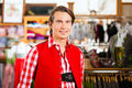 Man is trying Tracht or Lederhosen in a shop Royalty Free Stock Images