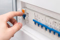 Man turning on the fuse box Royalty Free Stock Photo
