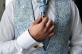 Man in a tux fixing his cufflink close up of groom bow tie cufflinks Royalty Free Stock Photos