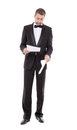 Man in a tuxedo reading the document stylish middle aged bow tie and his hand Stock Photos