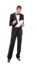 Man in a tuxedo reading the document stylish middle aged bow tie and his hand Royalty Free Stock Image
