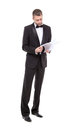 Man in a tuxedo reading the document stylish middle aged bow tie and his hand Stock Image