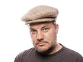 Man with tweed cap in his forties Stock Photography