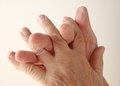 Man twines fingers together an older crosses the of one hand with the other Royalty Free Stock Photo