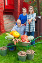 Man and two women with  vegetables in garden Stock Images