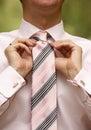 Man tying necktie Royalty Free Stock Photo