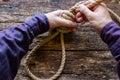 Man tying a slipknot Royalty Free Stock Photo