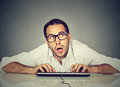 Man typing on keyboard wondering about reply Royalty Free Stock Photo