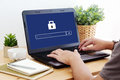 Man typing password on labtop screen background, cyber security Royalty Free Stock Photo