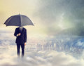 Man with Umbrella Above the City Stock Image