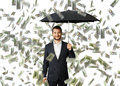 Man with umbrella standing under money rain successful smiley businessman black Stock Image