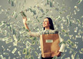 Man under dollar s rain smiley businesswoman with paper bag catching money Stock Photography