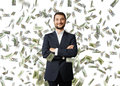 Man under dollar s rain successful and smiley businessman standing Stock Images