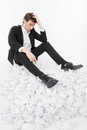 Man under stress sitting on a lot of papers Stock Photo