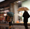 Man under umbrella motion blur Stock Photo
