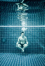 Man under water in a swimming pool to relax in the lotus positio position Stock Photography