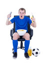Man in uniform watching football game and celebrating goal isola Stock Photos