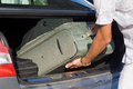 Man unload boot of a car closeup hand with suitcase Royalty Free Stock Images