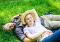 Man unshaven and girl lay on grass meadow. Guy and girl dreamy sleepy enjoy tranquility nature. Couple in love having Royalty Free Stock Photo