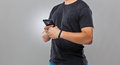 Man use mobile phone sync with wearble device gray background Royalty Free Stock Photo