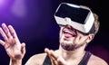 Man uses virtual realitiy vr head mounted display has fun using his glasses Royalty Free Stock Images